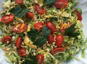 Organic Brussel Sprout Salad with Toasted Pine Nuts Meyer Lemon and Grape Tomatoes